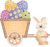 Happy Bunny Pushing Cart Full of Easter Eggs Royalty Free Stock Images
