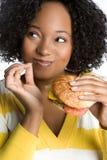 Happy Burger Woman. Pretty happy woman eating burger Royalty Free Stock Photo