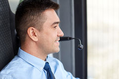 Happy bus driver face with microphone Stock Image