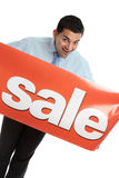 Happy businesman or saleman with sale sign Royalty Free Stock Photos