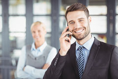 Happy businesman talking on mobile phone Stock Photography