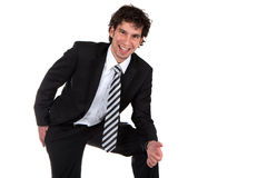 Happy Business. Laughing business man before white background Stock Images