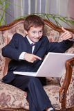 Happy business boy pointing in computer screen Royalty Free Stock Photography
