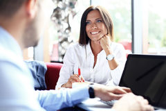 Happy business colleagues in modern office Royalty Free Stock Photography