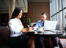 Happy business colleagues in modern office Royalty Free Stock Image