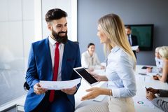 Happy business colleagues in modern office using tablet royalty free stock image