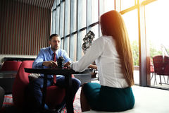 Happy business colleagues in modern office Royalty Free Stock Images