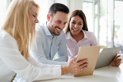 Happy young business colleagues in modern office royalty free stock photography