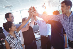 Happy business colleagues putting their hands together. At office Royalty Free Stock Photo