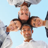 Happy business colleagues  with their heads together Stock Photo