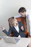 Happy business couple. In the office Royalty Free Stock Photo