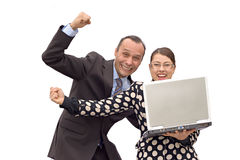 Happy business couple. Business couple receiving good news and celebrating Royalty Free Stock Photography