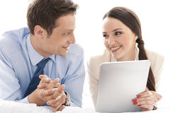 Happy business couple with digital tablet looking at each other in hotel Royalty Free Stock Photography