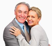 Happy business couple embracing on white Stock Photo