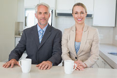 Happy business couple having coffee before work in morning Stock Photos