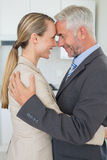 Happy business couple hugging each other before work in morning Royalty Free Stock Images
