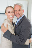 Happy business couple hugging each other before work in morning. T home in the kitchen Royalty Free Stock Photography