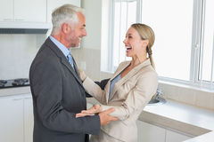 Happy business couple laughing together before work in morning Stock Images