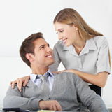 Happy business couple in office Stock Photography