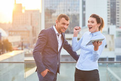 Happy business couple outdoor. Man and woman, city. Learn to win Stock Image