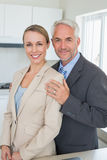 Happy business couple smiling at camera before work in morning Stock Photos