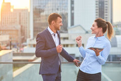 Happy business couple with tablet. Royalty Free Stock Photography