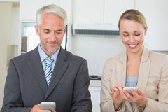 Happy business couple texting before work in morning Royalty Free Stock Photography