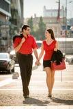 Happy business couple walking street Stock Photos