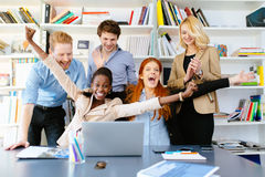 Happy business coworkers celebrating Stock Image