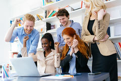 Happy business coworkers celebrating Stock Photography