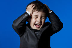 Happy business, cute little boy portrait over blue chroma backgr Royalty Free Stock Photos
