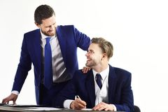 Happy business and employee benefits concept. Manager and employee with happy faces. Boss with beard talking to office worker. Businessman smile with his young stock photography