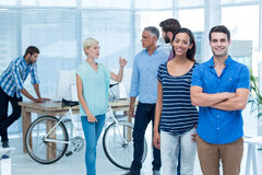 Happy business friends standing with arms crossed Stock Photo