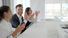 Happy business group clapping hands In slow motion, employees applaud in office, colleagues near desk stock footage