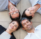 A happy business group lying in a circle Royalty Free Stock Photo