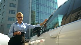 Happy business lady getting into luxury auto, successful purchase, car loan. Stock photo royalty free stock photos