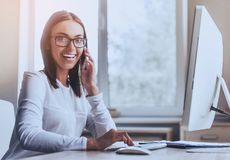Happy Business Lady Using Computer in Office. Stock Images