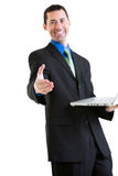 Happy business male on laptop gesturing handshake Stock Image