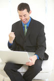 Happy business male on laptop Stock Photography