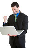 Happy business male on laptop Royalty Free Stock Photography