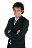 Happy business man. Business man with folded arms Royalty Free Stock Photography