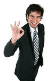 Happy business man. Happy and successful young business man giving a positive sign Stock Photos
