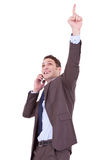 Happy business man with cellular phone Stock Images
