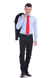 Happy business man with coat over shoulder Stock Image
