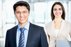 Happy business man with colleague Royalty Free Stock Image