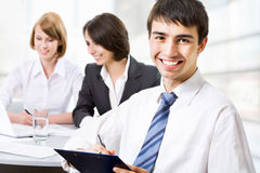 Happy business man with colleagues Stock Images