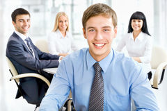 Happy business man with colleagues Stock Photo