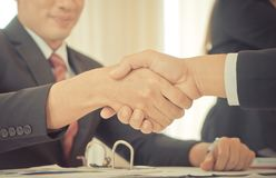 Business man with confidence handshake with partner. Happy business man with confidence handshake with partner stock photography