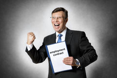 Happy business man with employment contract Royalty Free Stock Photos