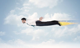 Happy business man flying fast on the sky between clouds Royalty Free Stock Images